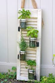 diy with an old shutter can also purchase from elizabeth kate recycled shutter mason jar herb garden love this idea