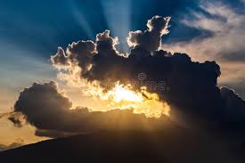 golden rays of the sun through the black clouds stock image image