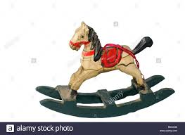 a small wooden rocking is a ornament stock photo