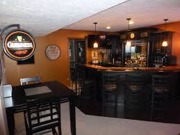 basement irish pub love the black cabinets and using the corner