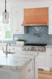 kitchen backsplash blue blue and gray kitchen features gray raised panel cabinets adorned