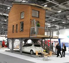 4 Car Garage Plans With Apartment Above by Architect Designs Tiny Flats To Stand On Stilts Above Car Parks