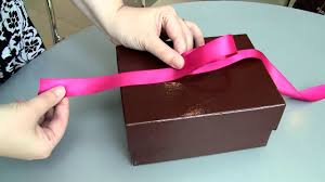 gift boxes with bow do it yourself how to tie a gift box bow like the pros