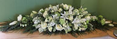 how to make a casket spray sussex florist delivering coffin spray funeral tributes