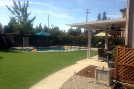 outdoor living area with child pool safety features paradise