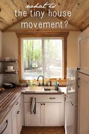 a tiny house kitchen and article on the tiny house movement by