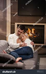 young couple hugging on sofa front stock photo 40360237 shutterstock