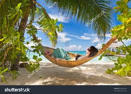 sleeping hammock under palms on stock photo 98024438