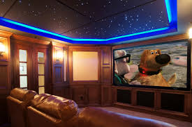 enjoyable blue ceiling lighting over tan leather sofa and wide lcd