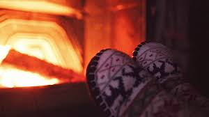 bare couple feet by the cozy fireplace 4k man and woman relax by