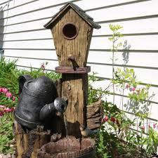 sunnydaze rustic birdhouse and garden watering can outdoor water