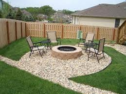 inexpensive patio ideas showing round stone fire pit with black