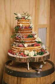 2 tiered wedding cake with cupcakes is an alternative to a multi