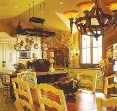 tuscan kitchen with white cabinets and hanging pot rack over