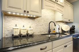 travertine backsplash kitchen traditional with ge slate brass