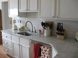 white kitchen cabinets with river white granite white river granite white subway tile white cabinets