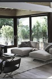 a living room with a grey three seat sofa chaise lounge and a