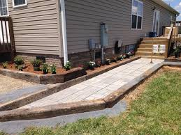 railroad ties and walkway with flower bed house ideas