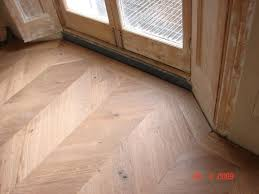 engineered oak parquet flooring in a chevron pattern