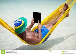 Brazillian Hammock Man Relaxes In Hammock On Brazilian Beach Royalty Free Stock