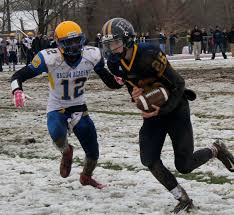 bacon academy rallies to defeat rham in thanksgiving