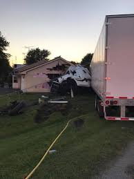 car collides with semi in carroll county semi crashes into home