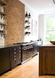 a brownstone in brooklyn reborn black cabinet exposed brick