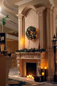 lovable green christmas wreath over hearth stone fireplace ideas