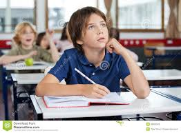 Kid At Desk by Caucasian Kid Writing At The Desk Stock Photo Image 55195005