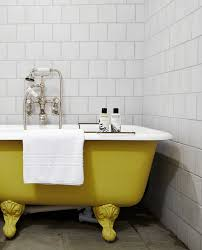 yellow roll top bath at babington house soho house bathroom