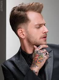 fashionable men u0027s hairstyle with a small quiff and an undercut