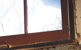 leaky basement window wells clogged window well drains