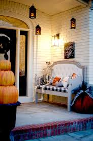 styling a fire themed halloween porch with a dragon yard inflatable