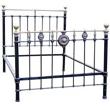 brass and iron bed with sunflower brass rosettes md33 at 1stdibs