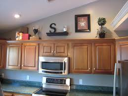 how to decorate kitchen cabinets tops kitchen cabinets awesome ideas for decorating above kitchen