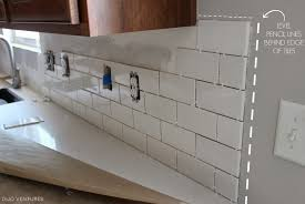 how to install a backsplash in the kitchen how to cut subway tile without saw how to install backsplash