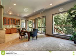 open floor plan dining room with view of kitchen cabinetry stock
