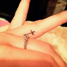 tattoo of a christian cross on harper lee