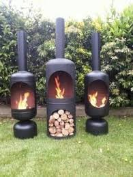 Outdoor Metal Fireplaces - barrel repurposed into fire pit bbq tired stove and backyard