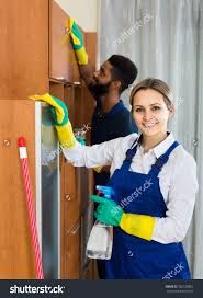 happy professional couple uniform cleaning stock photo