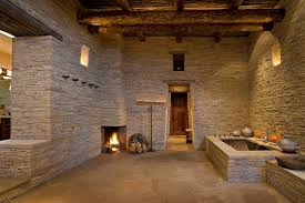 bathroom with tub and fireplace hooked on houses wood and stone