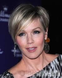 short hair cuts to your ears jennie garth short hair pulled behind ear not cut over ear