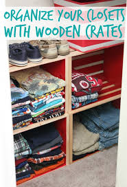 an organized closet using wooden crates happy go lucky