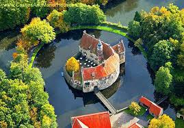 photographs of castles and manor houses around the world