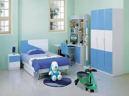 bedroom white and blue color room for kids furnished with creative