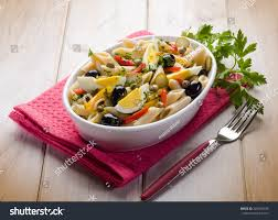 cold pasta salad with capsicum olives capers and boiled eggs stock