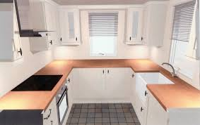 u shaped kitchen designs by brown wooden countertop and silver