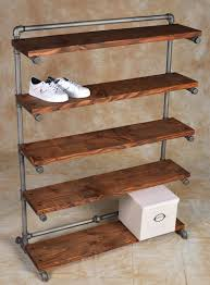 Steel Pipe Shelving by Pipe Comes In Rust Sandblast Black Or Bronze Finishes Projects