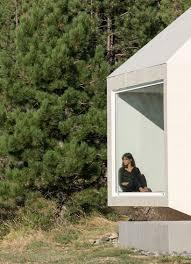 exe studio u0027s mountainside home in serbia uses textured monochrome