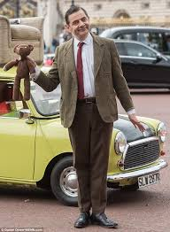 mr bean at buckingham palace on his green mini to celebrate show s